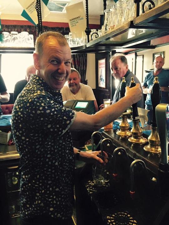 Alan Comer pulling pint