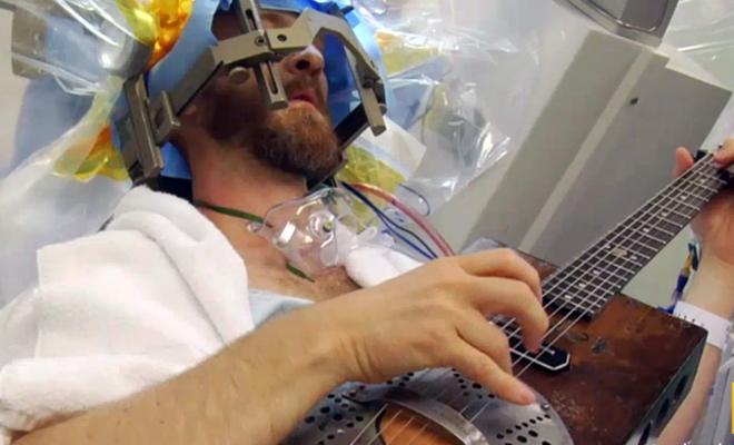 Brad Carter playing guitar
