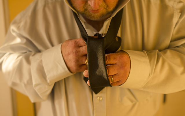 Putting on a tie can often be difficult for people with Parkinson's