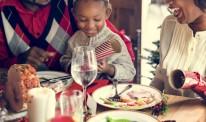 African descent family enjoying christmas dinner