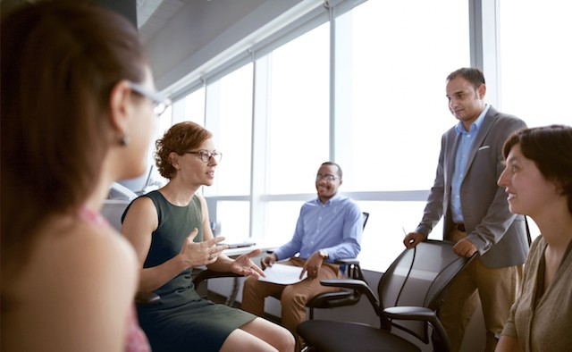 woman talking with business colleagues in office