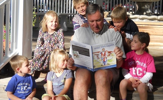 Kirk reading to his grandchildren