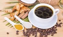 Bulletproof coffee blended with virgin coconut oil, turmeric, cl