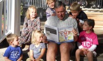 Kirk reading to his grandchildren