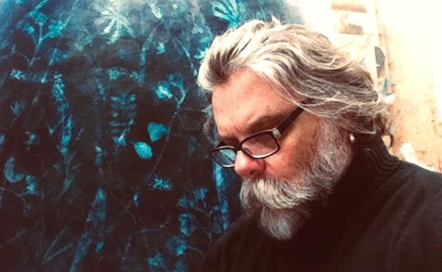 Artist Timothy John in his studio