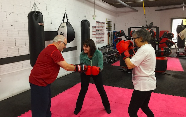 Members of a Parkinson's movement clinic boxing.