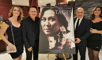 The cast and crew of the film 'STAGES' stand aside the film poster
