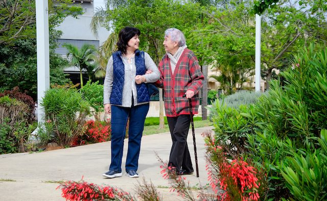 Person with Parkinson's and carer
