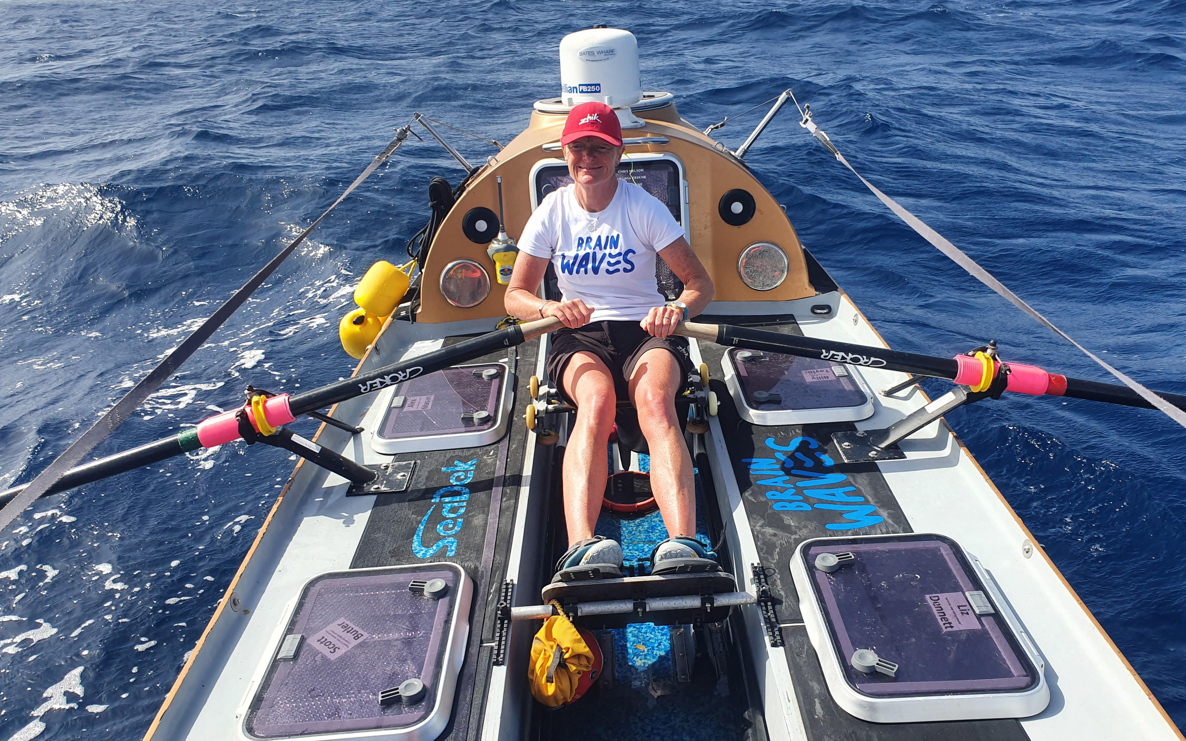 Liz Dennett rowing in the ocean