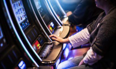 Casino Slot Gamblers. People Playing Video Slot Machines Inside Las Vegas Located Casino.
