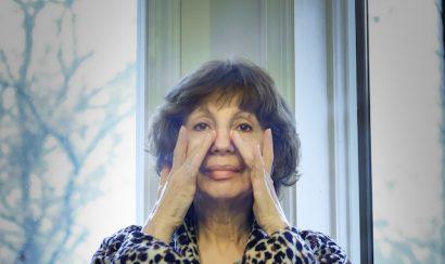 Older woman looking at mirror