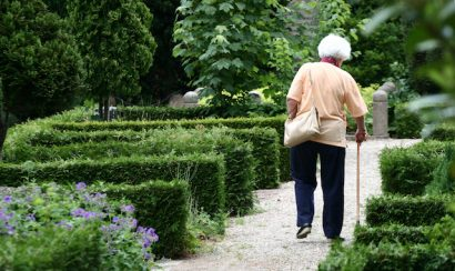 Elderly woman walks on path
