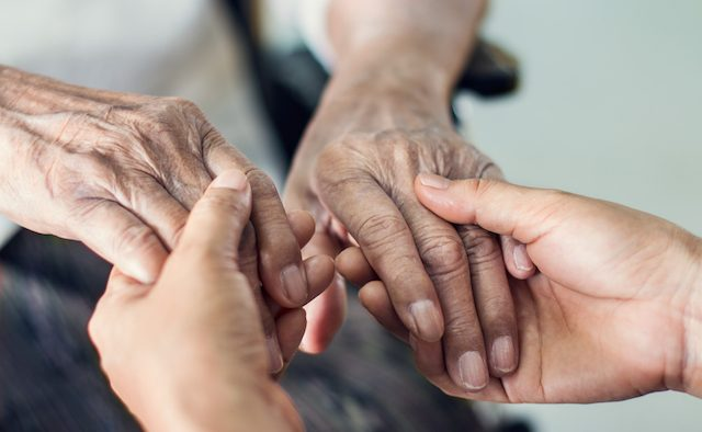 Close up hands of helping hand