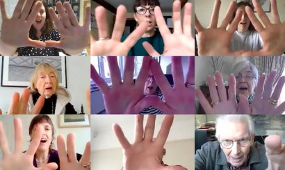 Hands raised on camera in group Zoom call
