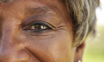 Close Up Of Smiling Senior Womans Eyes In Park