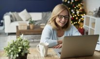 Woman having video conference during Christmas at home