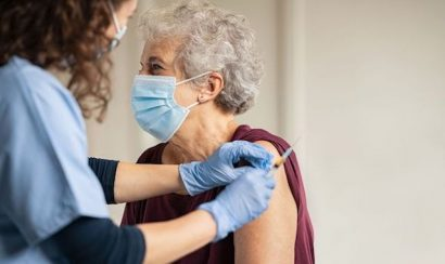An older woman receives a vaccine