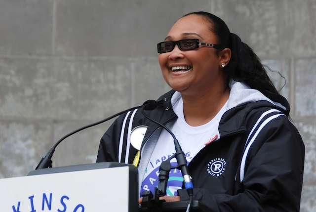 May May Ali smiles at a Parkinson's Unity Walk podium