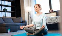 A woman meditating on a yoga mat