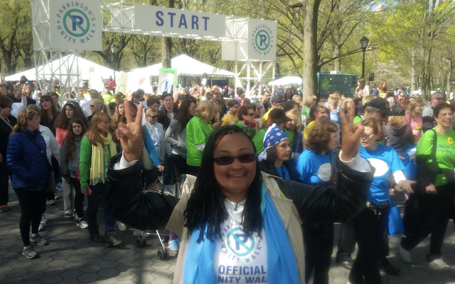 Maryum Ali stands in front of a crowd at a Parkinson Alliance Unity Walk.