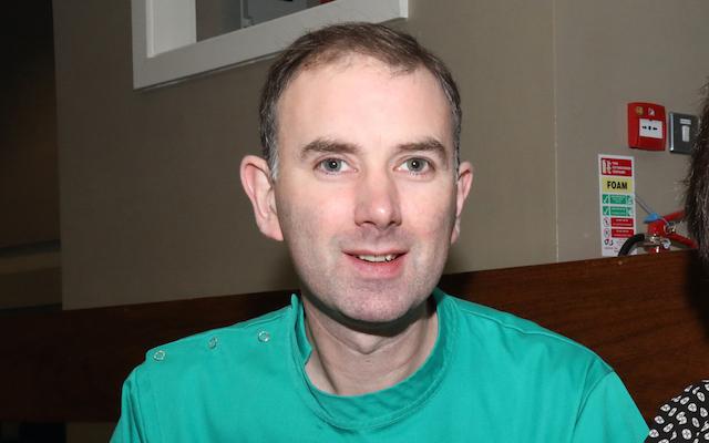 A headshot of Brian Magennis wearing his advanced nurse practitioner uniform.