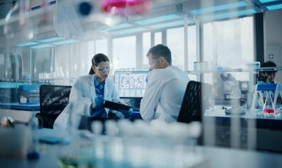Two scientists sit in a lab.