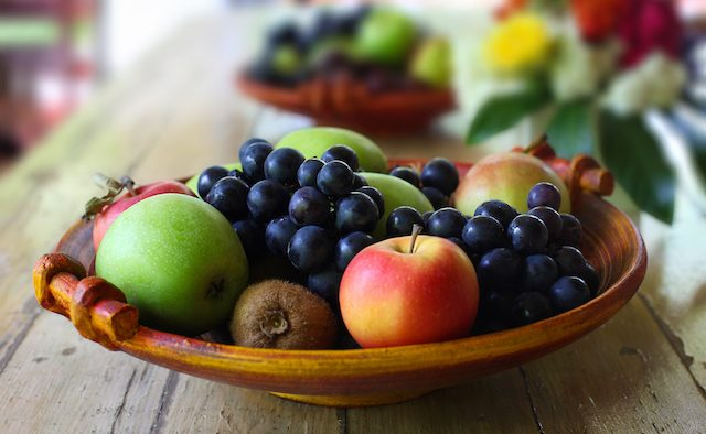 A bowl of fruit sits on a table.