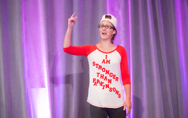Samantha Felder at a performance, wearing a shirt that says 'I am stronger than Parkinson's'.